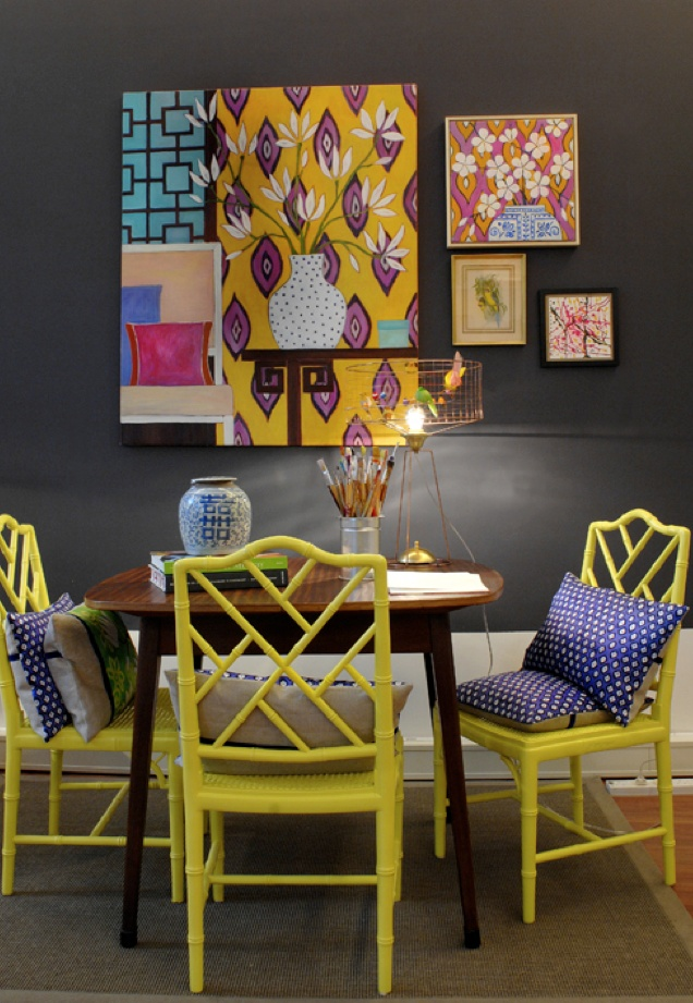 gorgeous pillows and yellow bamboo chairs, ginger jar, small dining table, Mariska Meijers flagship store via Kiki's List I want a small dining table!!