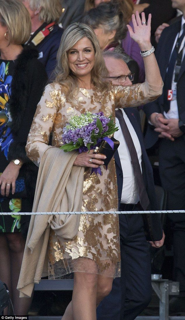 Queen Maxima stunned in a glitzy golden gown as she attended the Liberation Day Concert in...