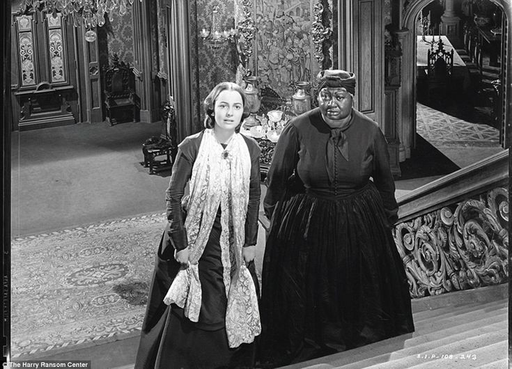 Together: Olivia de Havilland is seen with Hattie McDaniel in the film...Gone with the Wind