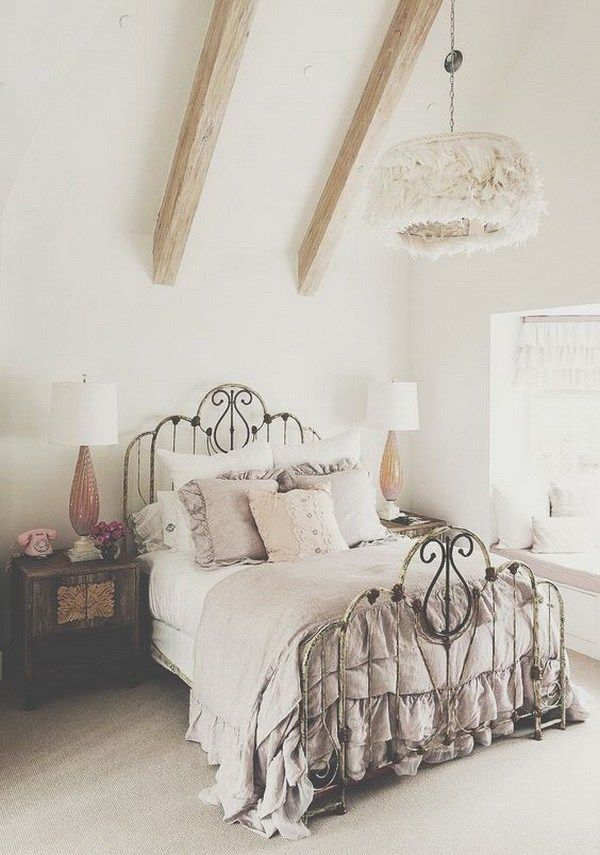 Vintage Gray Bedroom with Wrought Iron Bed and Wood Dresser.