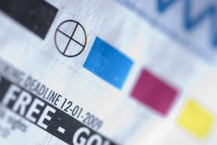 Free Stock Photo: Selective focus extreme close up on printer registration mark and color swatches on paper - By freeimageslive contributor: gratuit