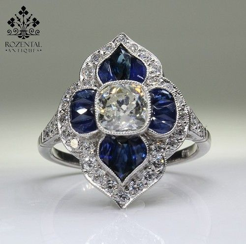ANTIQUE ART DECO PLATINUM DIAMOND & SAPHIRES RING  Love the shape of the calibrated sapphires on this one