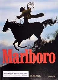 Beginning in the 1950s Marlboroads featured cowboys riding through the wide-open terrain of the Wild West. The cowboy was instantly recognizable in denim, leather chaps, boots, spurs, and Stetson hat. Almost exclusively white, he is portrayed as handsome, weathered, and fit. Both a role model and sex symbol, the cowboy appeals to men and women alike.