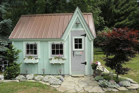This shed doubles as garden tool storage space and a lovely play cottage for two very lucky granddaughters. Inside, they have space to do art projects under the soft pink glow of fairy lights, and sit with their grandparents for some quality playtime.