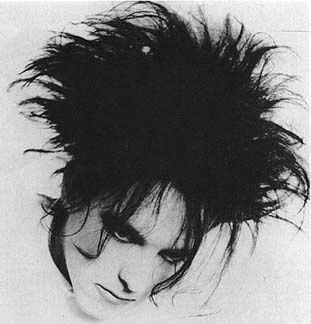 Robert Smith from the band The Cure ( one of my top favs in the 80's and today )