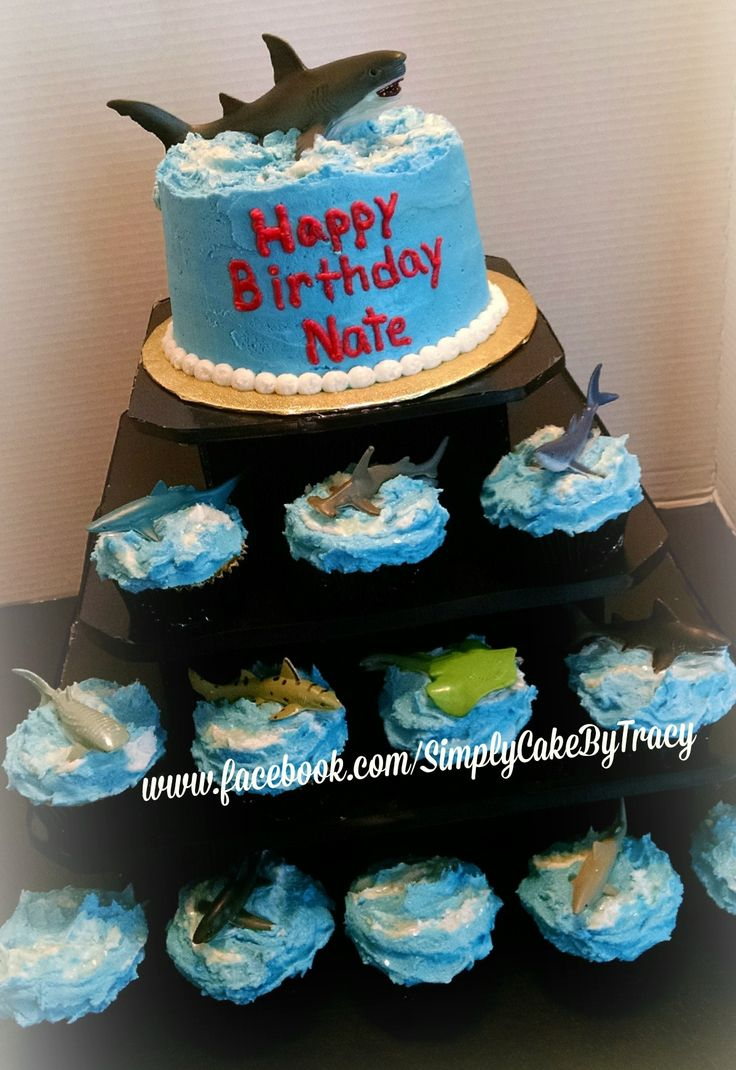 Shark themed cake and cupcake tower. Sharks purchased from Michaels.