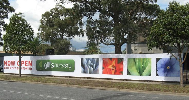 Vinyl mesh banner on a cyclone fence.