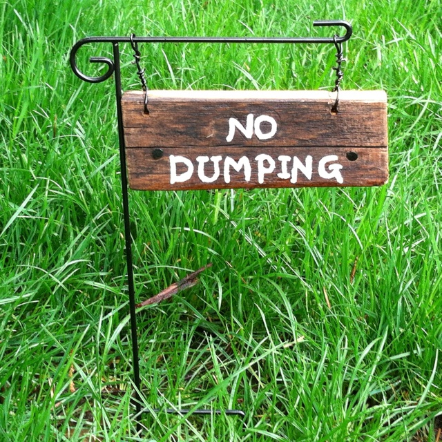 "We are tired of the neighbors walking their dogs to our front yard to ""take a dump""....so, I made this sign. Do you think they will get the message?!?! NO DUMPING!"