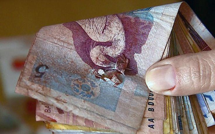 Um comerciante brasileiro de 56 anos levou um tiro no peito durante um assalto. A sorte foi ter um molho de notas no bolso, que lhe salvou a vida.
