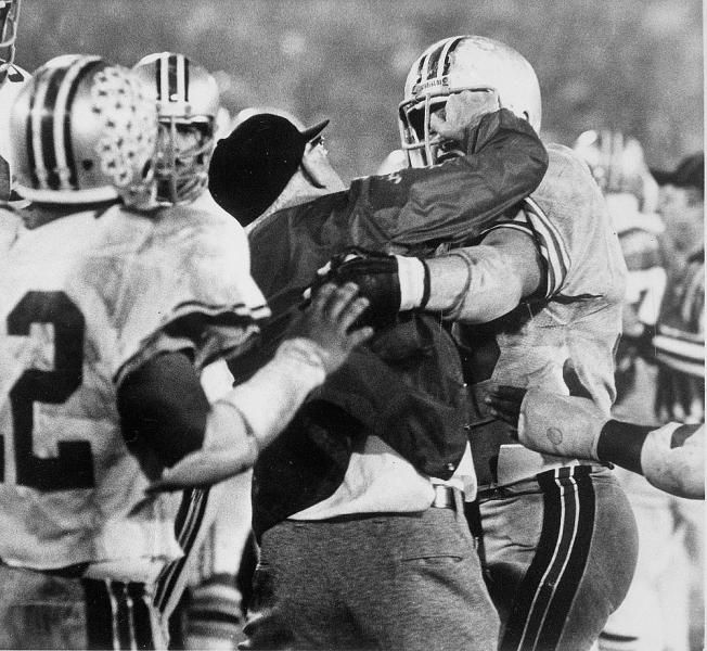 Ohio State coach Woody Hayes grabs the face mask of Ken Fritz (