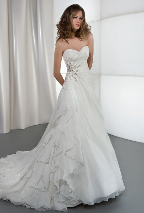 Brides: Demetrios - Illusions. Satin, organza, strapless with a sweetheart neckline and wrap bodice with asymmetrical ruching. A-line skirt features side draping with beaded applique, embellished with Swarovski crystals and an attached train. Available in white and ivory.