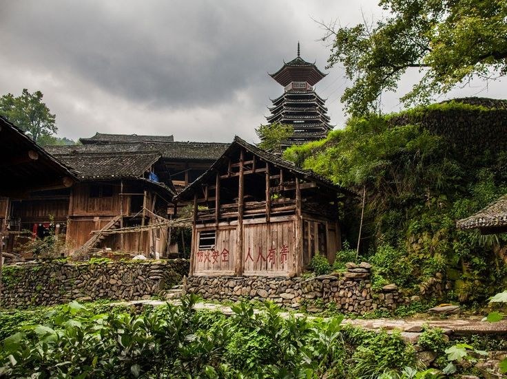Guizhou, terraced with lush rice paddies and dotted with elaborate wooden…