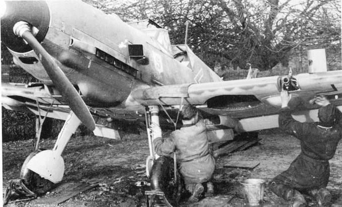 Messerschmitt Bf 109E of leading Luftwaffe ace Adolf Galland receiving field maintenance in 1940.  Galland flew this aircraft (5966) whilst commanding JG 26 in the Battle of Britain; his 106 combat victories were all scored against the Western allies.  He survived the war and lived until 1996.