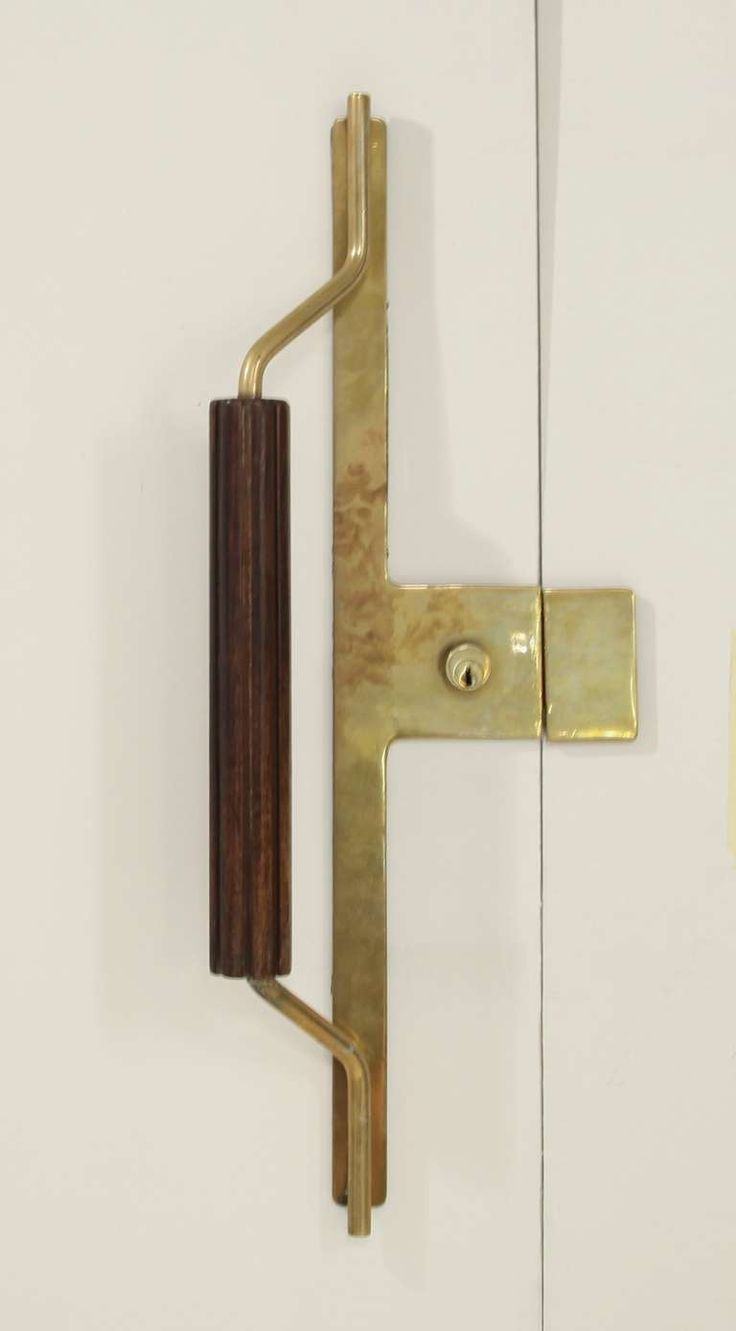 An Italian two sided brass door knob with solid wooden grips. image 3