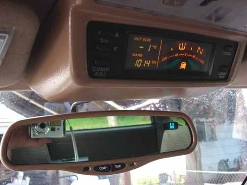 Auto dimming mirror mod with compass and temp.  http://www.yotatech.com/f126/gen-3-auto-dimming-mirror-install-134748/