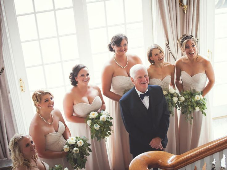 Bridesmaids and the bride's father's reaction to seeing her for the first time