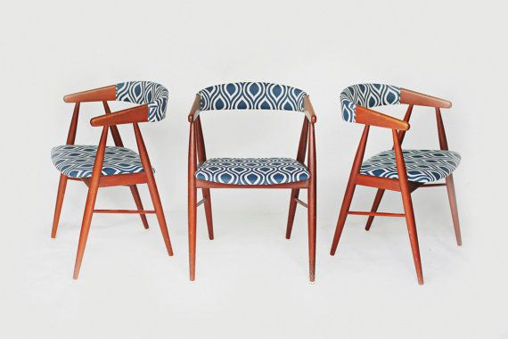 Mid century modern/danish dining or accent chairs. Newly reupholstered with a navy and ivory teardrop cotton upholstery fabric.    Price