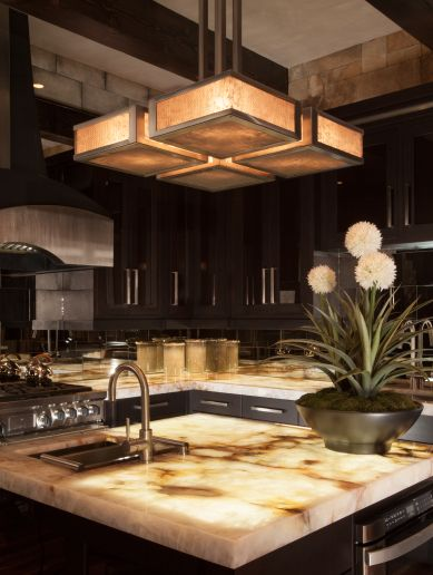 122 best lighting fixtures images on pinterest chandelier contemporary lodge style chandelier by hammerton lighting in forged iron with mica shades suspended over illuminated onyx island counter top aloadofball Images