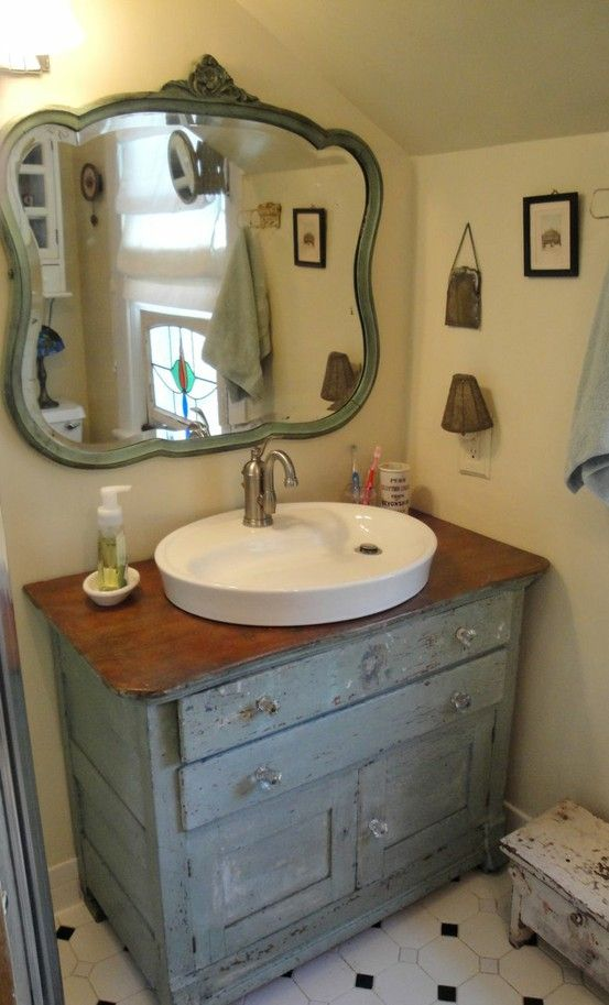 bathroom in grey... repurposed dresser into vanity and dresser mirror hung on the wall for a vanity mirror...