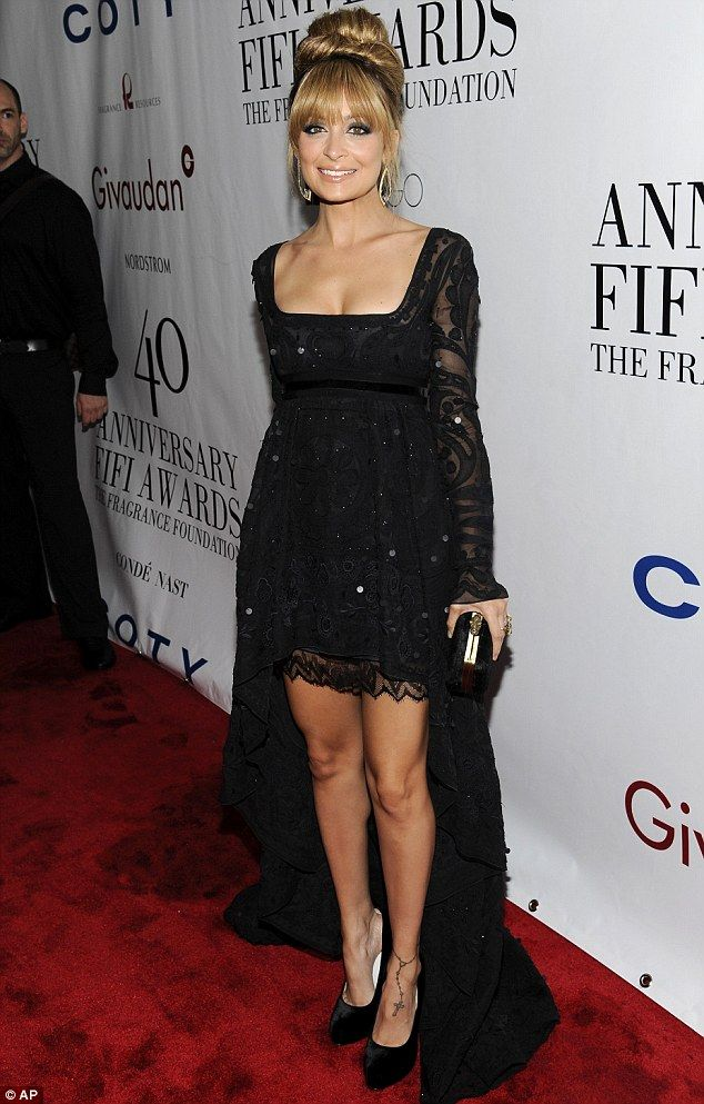 Nicole Richie goes back to the Sixties with beehive 'do as she wows in black minidress and sweeping train at FiFi Awards