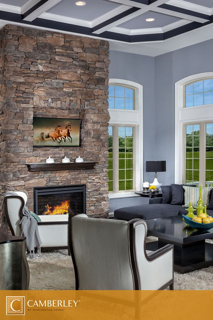 Tall Windows Illuminate The Beautiful Brick Fireplace Adding Coziness To High Ceiling Living Room In Langley II Model Neutral Colors Of