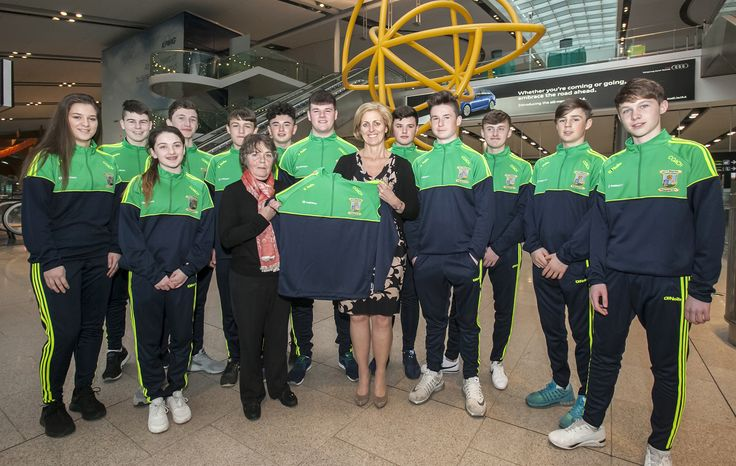 Coaches from St Margaret's GAA club receiving new tops