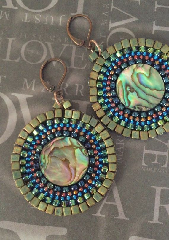 Beaded Earrings - Abalone Shell Seed Bead Disc Earrings - Handmade Beadwork Jewelry  Beaded abalone shell hoop earrings created with abalone shell coin beads with green and metallic copper 11.0 and 8/0 seed beads. Each bead is individually hand sewn and expertly woven to make these beautiful earrings. The earwires are 14kt gold plated. These very popular abalone disc earrings measure approximately 2 inches. The discs are 1.25 inches. Lightweight and fun to wear. Great for any style and…