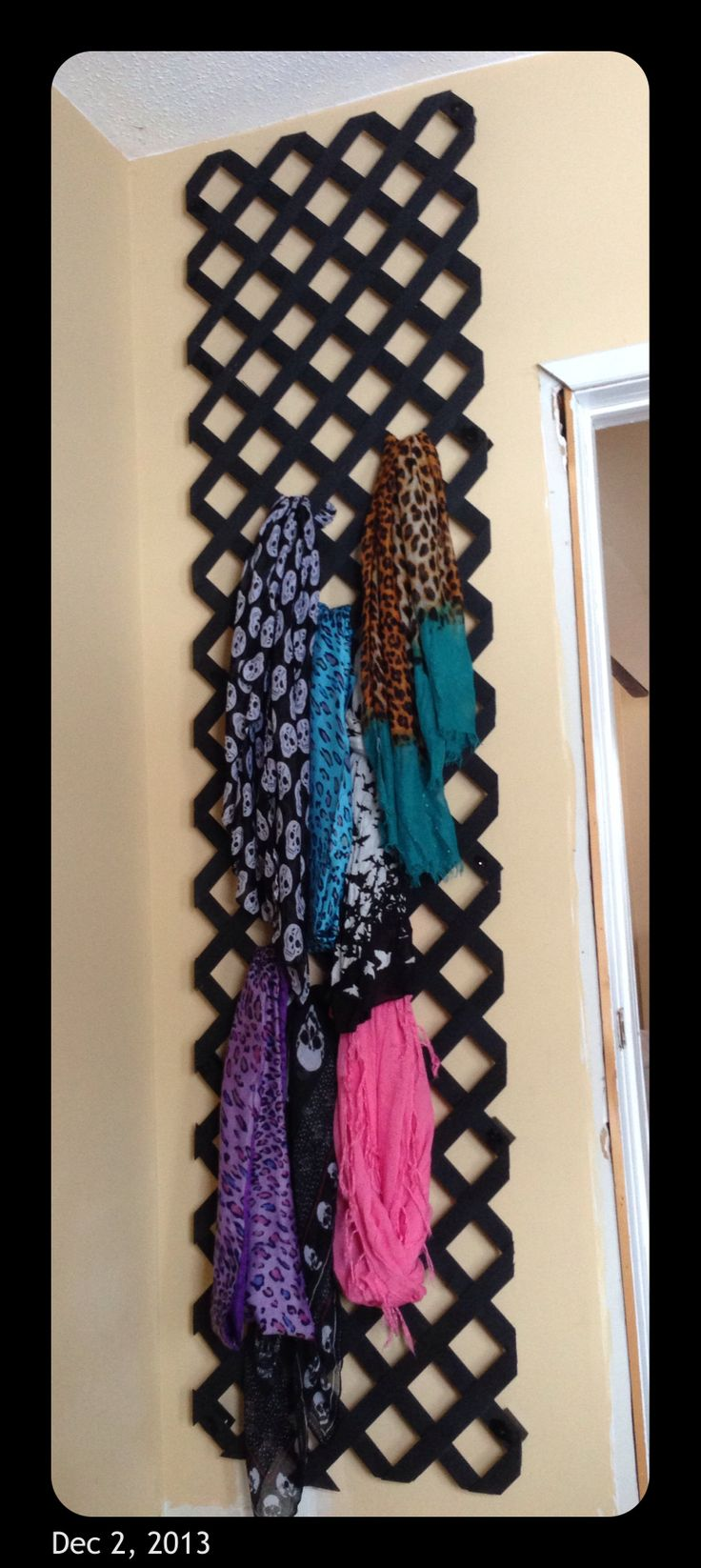 Scarf storage.... A piece of lattice, with blocks of wood behind it so it sits away from the wall.