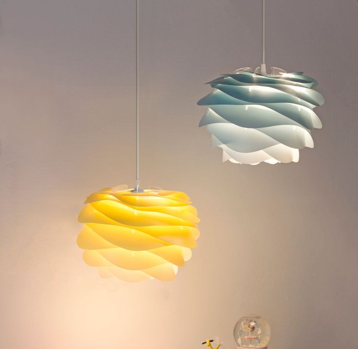 Brightly coloured Carmina lampshades light up the bedroom.