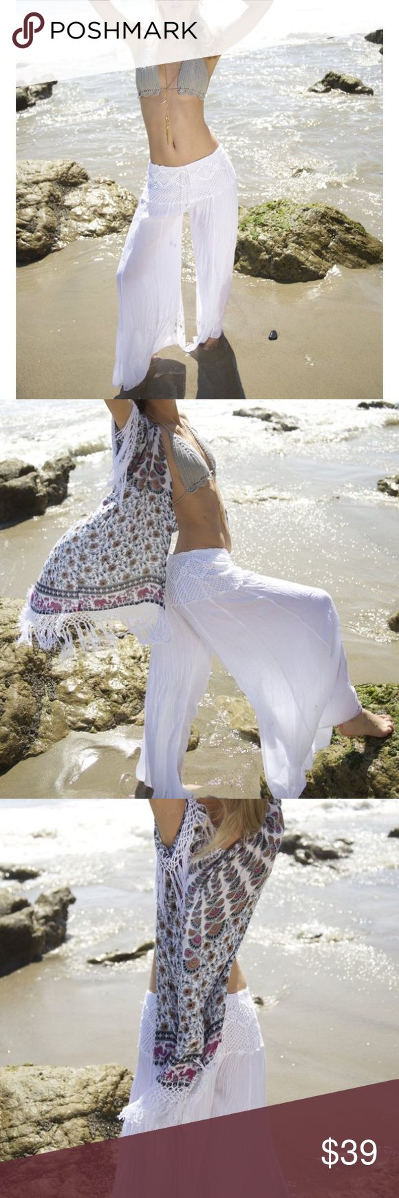 White crochet beach pants palazzo pants We die for these hand crochet wide leg beach pants, featuring 100% cotton material, hand crochet and elastic waist, and palazo fit. Perfect for any festival outfit, or even just a beach stroll!  Content + Care  100% cotton hand crochet hand wash hang dry Size + Fit  these are a one size item fitting a S-L because of the wide flowy fit and elastic waist the fit up to a 12 in pant Pants Wide Leg