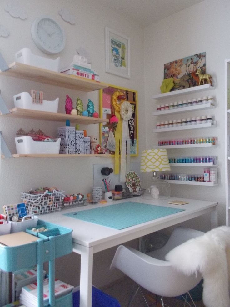 love the picture shelves turned storage on right. shelves like these but in white. ikea desk... set!