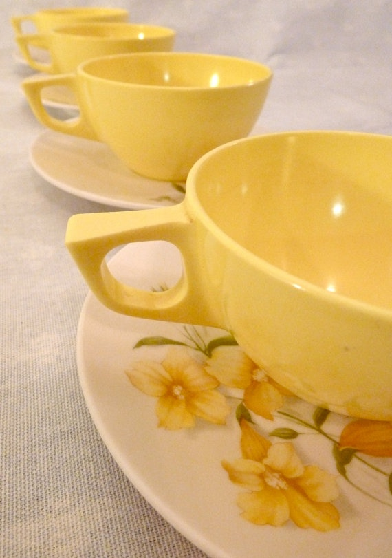 Vintage yellow melamine  cups and saucers 1960's. I love old melamine dishes!!  They came in so many colors and prints.  I have some with pink roses.