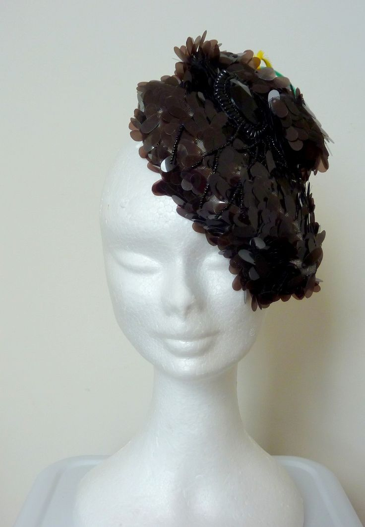 """Black cocktail hat/race hat Black teardrop shaped sequins, black """"jewel"""" feature and tri colour biot feathers.Oval shape base. Hand made and hand blocked."""