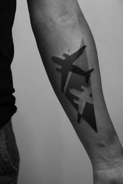 Abstract dotwork airplane tattoo on the left inner forearm. Más