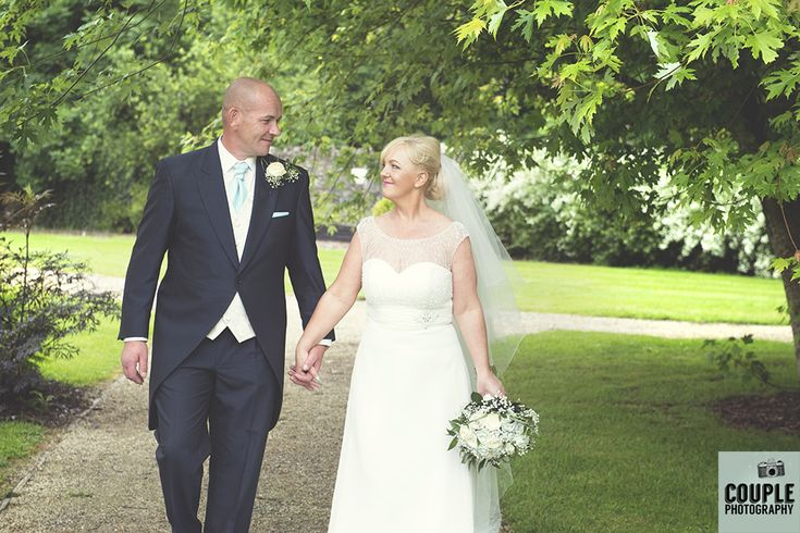 The happy couple go for a stroll. Weddings at The Johnstown Estate, photographed by Couple Photography.