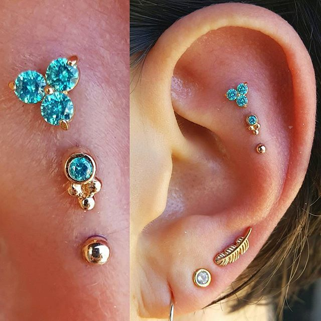 That's the spirit, Berkeley! The first piercings of the day. Who needs coffee when you have a solid 14k gold and mint CZ triple to start off your morning? We also added a third lobe piercing with a solid gold feather. This project features jewelry from @anatometalinc, @bvla, @bodygems. This is one decadent ear. Let's keep it going, @industrialberkeley!