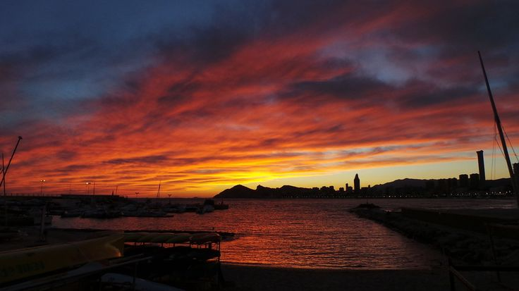 Sunset over Benidorm (clouds sunrise+sunset city+skyline ). Photo by Chefsolar