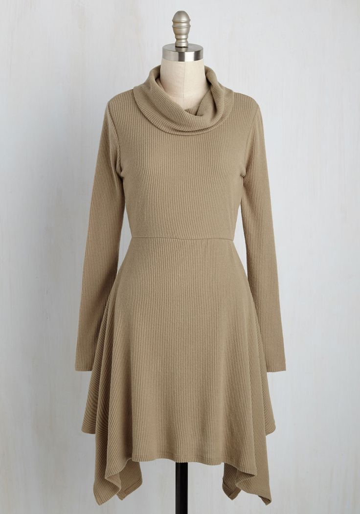 If a cup of tea, a cushy chair, and this tan sweater dress sound like you ideal afternoon, then you're not alone! We also can't stop swooning over the sharktail hem and the oh-so-soft finish of this turtleneck A-line, and how it brings warmth and well-being with every wear.