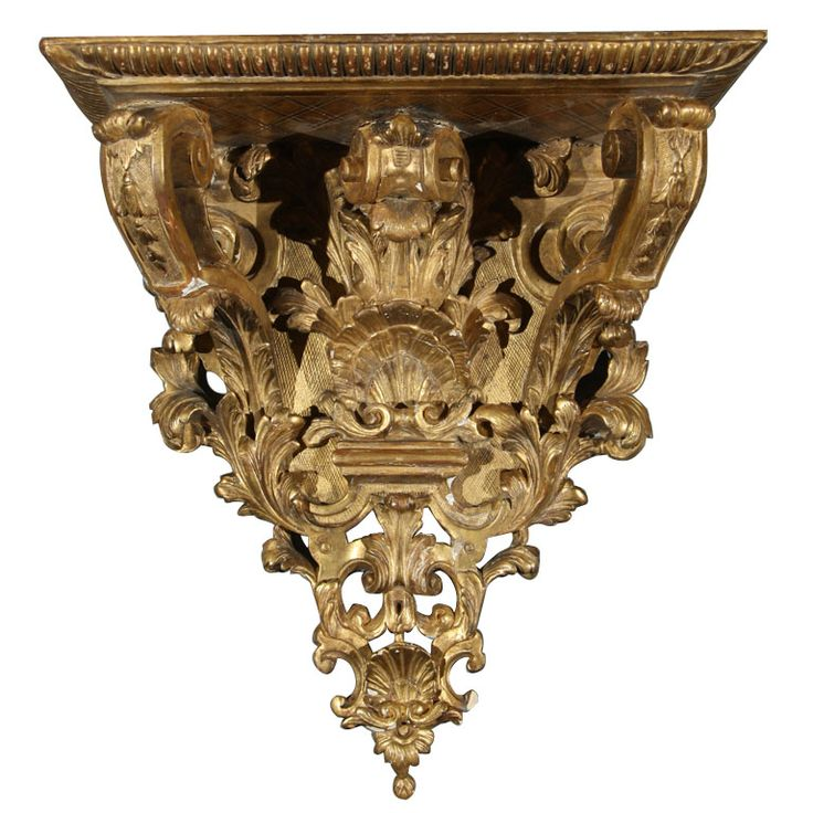 a carved and gilt wall bracket with shells acanthus leaves and bell flowers circa