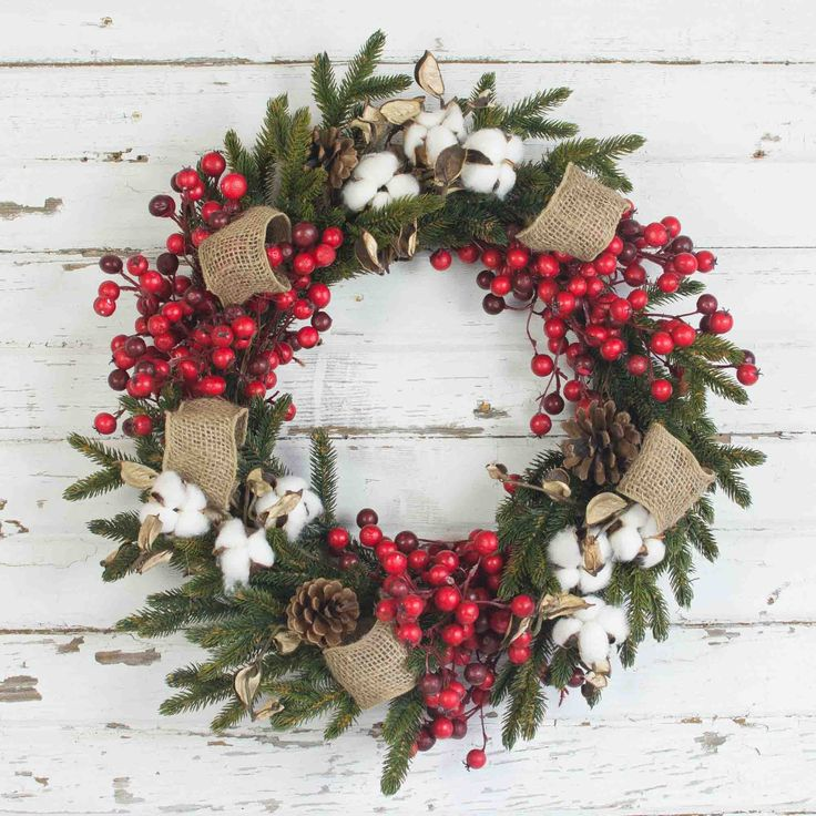 This 18 inch wreath is a classic for your traditional Christmas holiday decor. The Cotton, Pine and Red Berry Wreath is crafted with life like cotton, green fol