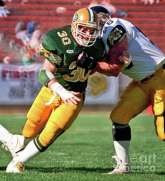 Action photograph taken of Edmonton Eskimos middle linebacker Danny Bass #30, in a 1988 game against the Hamilton Ti-Cats.