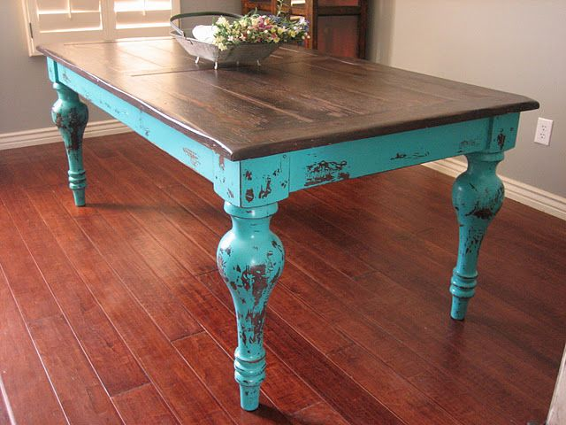 Rustic Turquoise Dining Table. Unique rustic stained top, lots of character and texture. Great chunky rolled legs. Turquoise distressed finish.
