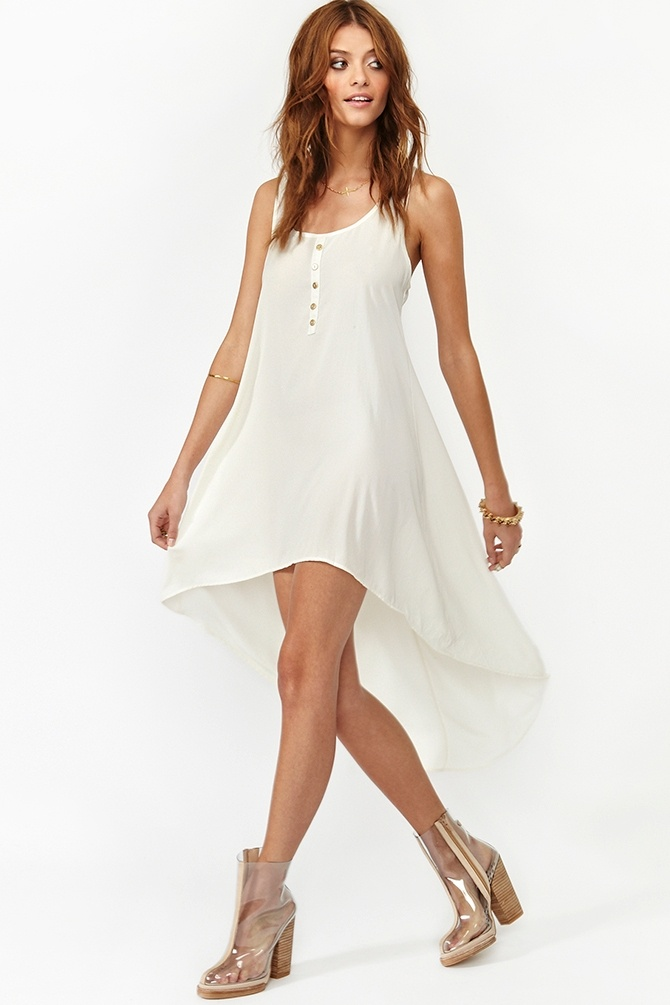 "Moondance Dress in Ivory - Silky ivory tank dress featuring gold button detailing and a long tail hem. Racer back, flowy fit. Unlined. Looks perfect paired with a wide-brim hat and fringe boots!     *100% Polyester  *30"" length at front, 47"" length at back"