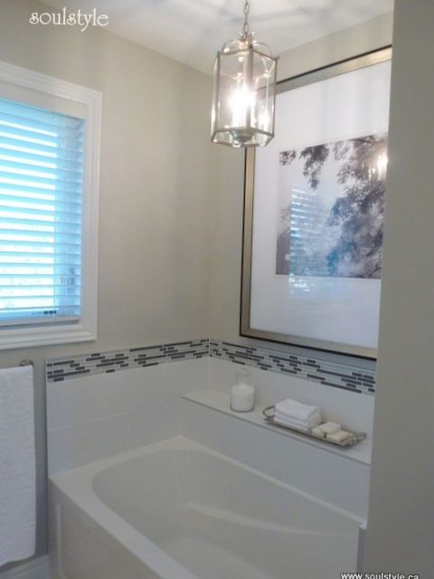 Update A Builder Grade Bathtub Niche With Some Glass Tile A Painting And A Mini Chandelier