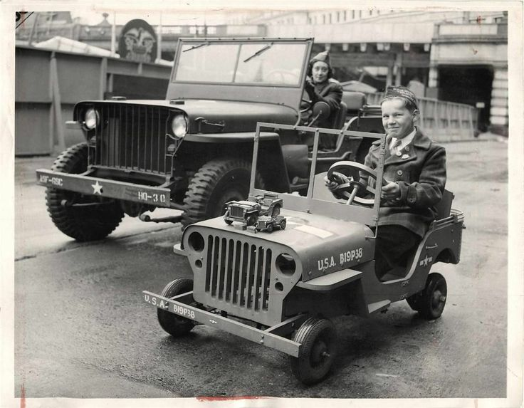 1943- Boy driving miniature Army jeep powered by refrigeration motor.