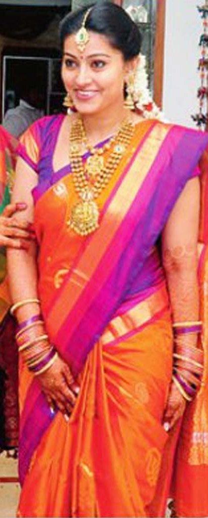 www.sameepam.com  South Indian bride. Temple jewelry. Jhumkis.Orange and purple silk kanchipuram sari.Braid with fresh jasmine flowers. Tamil bride. Telugu bride. Kannada bride. Hindu bride. Malayalee bride.Kerala bride.South Indian wedding.Sneha's engagement