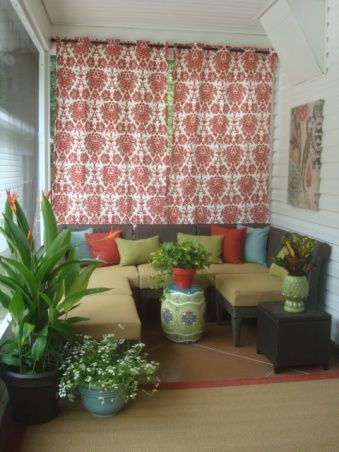 A small back porch area was screened-in to create a cheery, inviting outdoor room with bright colors and patterns, complete with furniture, rug and curtains. Description from pinterest.com. I searched for this on bing.com/images