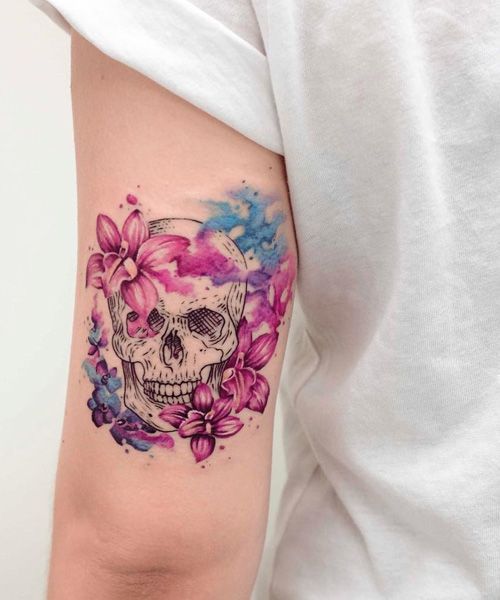 Astonishing Orchids and Skull Tattoo Design, A mix of soft and power showing its strength giving pretty look to women and girls.