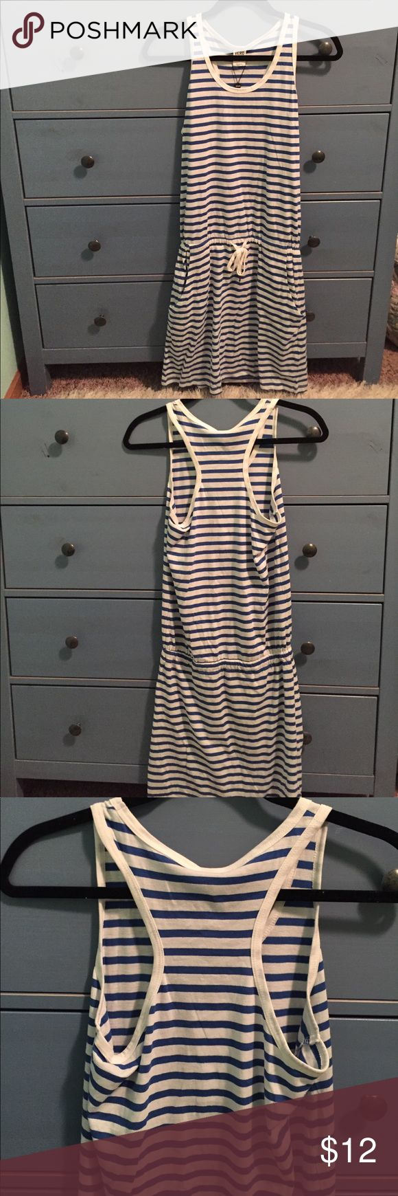 Drop-Waisted Striped Racerback Dress This NWT dress is a drop-waisted summer dress with a tie that tightens that waist. It has a racerback and pockets. It hits at about the knee. Would make an adorable cover-up for a swimsuit or could be worn by itself. It was purchased from Modcloth and is the brand Vero Moda. ModCloth Dresses Midi