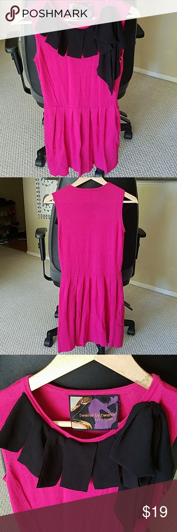 Adorable pleated hot pink dress with bow detail Classy dress, wear with tights at work, to go to a nice dinner/event, or fun weekend wear! Can dress up or down. Black bow detailing at collar and pleated skirt. Great for petite ladies. Dresses